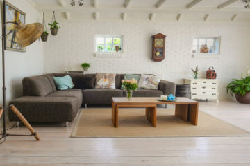 Stylish front room with a tripod antique lamp